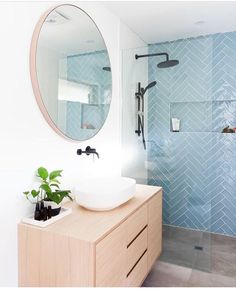 An updated, feminine bathroom idea. Herringbone shower tile in a peaceful aqua contrasts nicely with the round mirror and light wood vanity. So stylish! Laundry In Bathroom, Bathroom Renos, Bathroom Renovations, Small Bathroom, Feminine Bathroom, Guys Bathroom, Bathroom Plants, Bathroom Vanities, Bad Inspiration