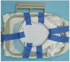 Painters' tape used to help machine embroider a baby onesie:  Machine embroidery in 6 Easy Lessons Nancy Zieman Eileen Roche