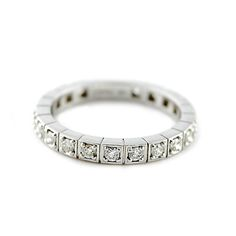 Diamond Band by Meira T. Beautiful contemporary styling with round brilliant diamonds, set in 4 prongs.  Each diamond is separated with bars, giving this gorgeous band a unique look.