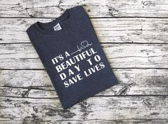 Inspired by the popular TV show Greys Anatomy, its a beautiful day to save lives T-shirt
