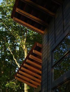 A Rustic-Modern Cabin Inspired by Japanese Bungalows and Shou Sugi Ban - Photo 2 of 12 - The home's board-and-batten siding is black-stained pine punctuated by Jeld-Wen windows.