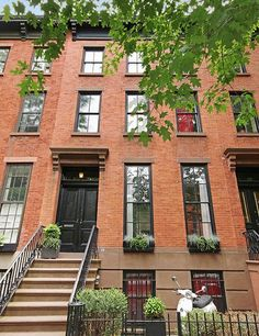 The handsome red-brick façade of the classic 1854 Cobble Hill townhouse.