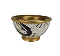 Brush Strokes - M. Clement's design studio looks to its home of New Orleans for inspired classical forms enhanced with exquisite hand-painted finishes. The handmade Clouet bowl reveals an artisanal meander pattern in bold onyx brush strokes with antique gold accents.