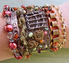 wonder wrap with crocheted sterling wire and bronze gate, velvet ribbon, mesh roses - Nina Bagley, artist
