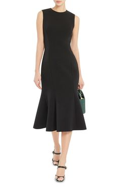 A sophisticated take on the ultimate LBD, this **Dolce & Gabbana** dress features a form-fitting silhouette with flared ruffled hem.