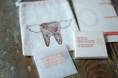 "tooth fairy kit: with fairy dust, a chart to keep track of the date and tooth that was lost, plus ""business cards"" for the ""Toothfairy"" to leave under the pillow"