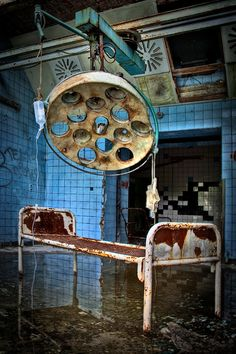 Abandoned - ...desolation and the backdrop of those bright blue walls...woo!