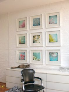 Bright, nature inspired photographs. IKEA Malm drawers lined up as a sideboard.