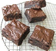 Try this King Arthur Flour brownie recipe - very moist, chocolatey brownies that slide out the pan. The top has that crisp sheen that cracks when cut, supposedly due to melting the butter and sugar together rather than creaming. Keeper recipe. 10/10