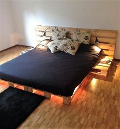This simple and modern designed DIY pallet wood bed is best for people who are carried away with the messy and complicated designs. Its easy to build and you can create extra space as side tables. You may add lamps as shown in the picture as an added advantage.