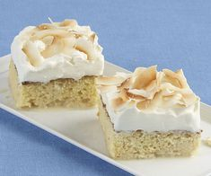 """Toasted Coconut Tres Leches Cake: In this twist on the classic Mexican tres leches cake, one of the three """"milks"""" is rich, nutty coconut milk. Rum and flaked coconut in the topping amp up the tropical flavor even further. Via FineCooking Great Desserts, No Bake Desserts, Summer Desserts, Coconut Tres Leches Cake Recipe, Cake Recipes, Dessert Recipes, Sweet Recipes, Toasted Coconut, Coconut Milk"""