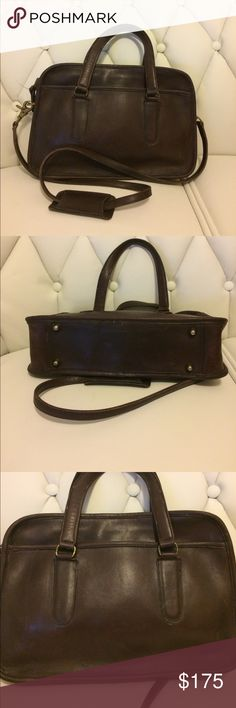 Vintage Coach NYC Skinny Flight Bag with Strap Reddish dark Brown color. Scratches and hardware tarnishing can be improved with cleaning and polishing. One small slit on the edge that may be repaired with glue or left as is Coach Bags
