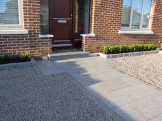 A stylish granite driveway featuring granite paving, granite setts, granite kerbing and limestone chippings.