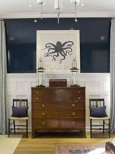 I really love the navy lacquered wall with board & batten, the graphic octopus art...and the shade of wood of that sideboard goes so well with navy