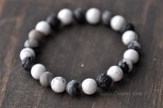 This essential oil diffuser bracelet is made with a stretch material for an easy fit. It is made with 8mm white howlite beads along with 8mm lava beads. The natural lava beads works perfectly for carrying your essential oils with you all day. Just a drop of your favourite essential