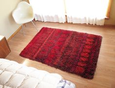 """There is no label so I do not know who made it or where. The rug is 45"""" x 70"""" and in very good condition with no major problems that I can find. The shag is bright and not matted or overused. This is a beautiful rug that will enliven any room. 