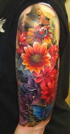 Flower sleeve, lots of color. No black outline, birth month flowers for my family. Half sleeve