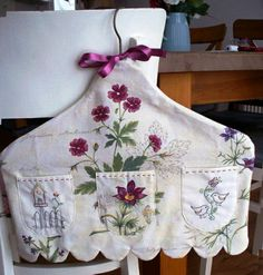 Covered hanger with pockets.  Do this in shabby colors and lace.  Would be beautiful.