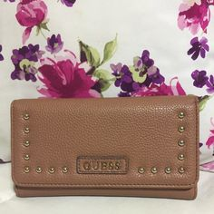 Brown studded guess wallet Excellent condition. Gently used. 13 card slots, 3 large pockets for bills and a change holder at the back. Guess Bags Wallets