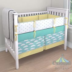 Crib bedding in Solid Teal, Solid Robin's Egg Blue, Seafoam Aqua Clouds, Solid Banana, Mint Stars. Created using the Nursery Designer® by Carousel Designs where you mix and match from hundreds of fabrics to create your own unique baby bedding. #carouseldesigns