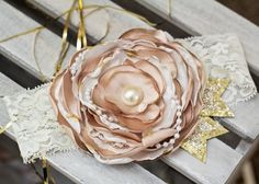 Champagne and Gold Satin Flower with Pearl and Lace detail.