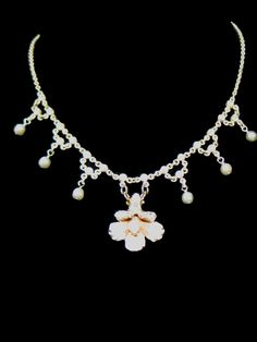 #8 ... Flower, Pearls and Rhinestones repurposed vintage necklace ... The full view of the silver vintage necklace with little clear rhinestones, with dangling faux pearls, and the vintage flower earring. This is a very sweet little necklace! $65.00 https://www.etsy.com/listing/164250680/
