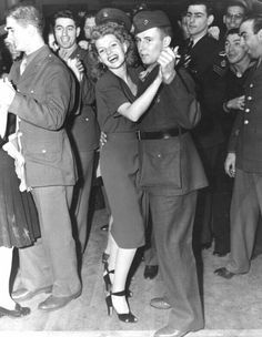 Rita dancing with a lucky serviceman at the Hollywood Canteen.