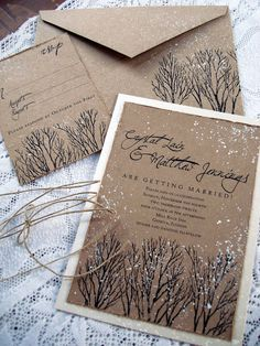 Have the envelope be a wedding color, or add small amounts of color to this branch and snow invitation style.