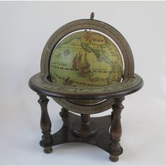 Old World Globe, Vintage Rotating Wood Small Desk Globe, Decorative... ($18) ❤ liked on Polyvore featuring home, home decor, wooden globe, wood globe, wooden home accessories, zodiac home decor and zodiac signs