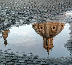shot of Italian cupola reflected in puddle