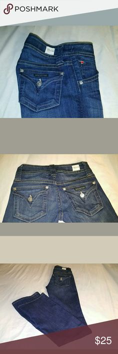 """Hudson Jeans bootcut midrise Cute Hudson Jeans in excellentcondition. Dark blue color, triangle back pockets .   NOTE:  These jeans are slightly twisted on the right leg see photo #4.   Measurements are approximate, lying flat not stretch.      Across waist 12 1/2""""     Rise 8""""     Hips 16 1/2 """"     Inseam 33""""     Leg Opening 81/2"""" Hudson Jeans Jeans Boot Cut"""