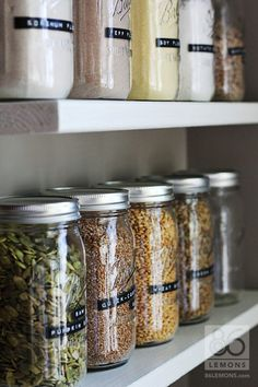 Open Pantry shelves with canning jars   http://86lemons.com- LOVE mason jars