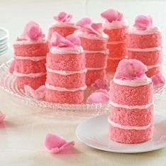 """Small treats are a delight! Cut 21 cake circles with the 2½"""" Biscuit Cutter. Arrange 7 mini cakes on a platter; then layer cake circles and pipe frosting as pictured. Top with Sugared Rose Petals."""