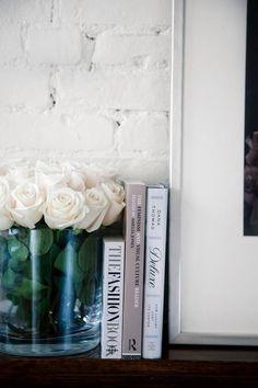 glass barrel of white roses.