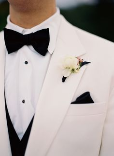 Black bowtie, white tuxedo jacket, classic groom // Elisa Bricker