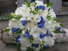 Hand tied wedding bouquet with white roses, white freesia and blue delphinium - http://www.blossomandbasket.com/product/blue-butterfly/