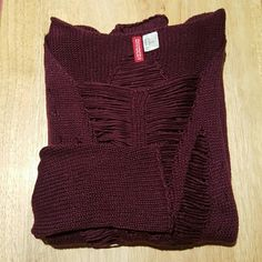 Distressed Oversized Maroon Sweater Distressed oversized sweater from H&M. Has scoop neck and rolled hem line. Destessed on both front and back and along sleeves. Selling only. No trades or PayPal. Reasonable offers considered if you use Make Offer button. Thanks for looking! H&M Sweaters Crew & Scoop Necks
