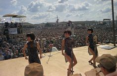"""The singing group the """"Korean Kittens"""" appear on stage at Cu Chi, Vietnam, during the Bob Hope USO Christmas show, to entertain U.S. troops of the 25th Infantry Division."""