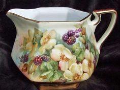 Porcelain pitcher painted by porcelain artist and teacher, Charlene Whitler
