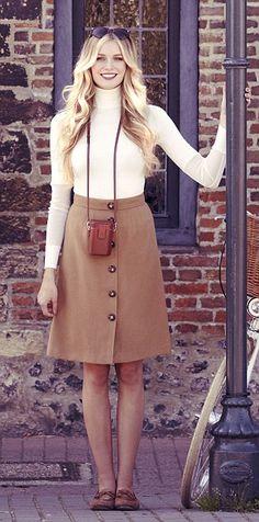 Polo-neck sweater, £95, reissonline.com. Skirt, £129, hobbs.co.uk. Moccasins, £15, newlook.com. Versace sunglasses, £189, sunglasshut.co.uk. Binocular case, leica.com