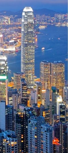 Night falls over Victoria Harbour, Hong Kong.  The harbour is a natural landform harbour situated between Hong Kong Island and Kowloon in Hong Kong.  The harbour's deep, sheltered waters and strategic location on the South China Sea were instrumental in Hong Kong's establishment as a British colony and its subsequent development as a trading centre.  Photo: google+