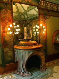 Art nouveau fireplace ~ I would build a house around this piece