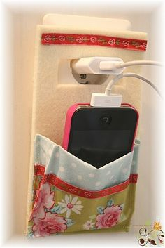 Ipod caddy while charging. could store cord in pocket when not in use.