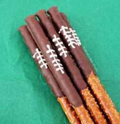 Chocolate Football Pretzel Sticks – sweet and salty, dark and white chocolate dipped pretzel rods. A delicious game day treat that screams team spirit!