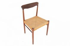 This gorgeous Møllerstyle dining chair is crafted in solid teak with a beautiful patinated paper cord seat. Not only does this chair offer a striking accent to your modern dining room or office, but it also provides ergonomicfunctionality.In excellent original condition with typical wear for its vintage.