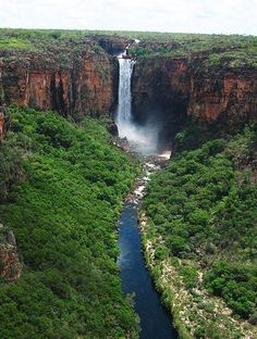 (Jim jim falls) The Jim Jim Falls is a plunge waterfall on the Jim Jim Creek that descends over the Arnhem Land escarpment within the UNESCO World Heritage–listed Kakadu National Park in the Northern Territory of Australia.it was formed over time by the constant flow of water eroding the sold Rock and the would would erode away all the soft rock. It has its shape because it takes long to erode hard rock.