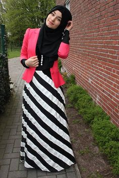 Hijabi--love the dramatic dynamic black and white lines of the maxi skirt with the neon pink blazer!
