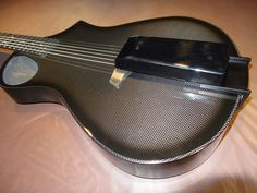 Once you try an Aspri Acero, you'll agree that it really adds a Carnegie Hall size to your guitar's sound. This unit (clipped-on to your guitar) will brighten the deadest room & turn your playing experience into an event. All that without having to modify your existing guitar in any way. And it gives new life to dead strings: think of it as your newest guitar tool. It's also easy to install & easy on the eyes. Aspri Acero; USD49.95 (bought new, on 13 June 2013); retailing for CA79.95 Carnegie Hall, Praise And Worship, Carbon Fiber, Guitars, June, Eyes, Room, Stuff To Buy, Bedroom