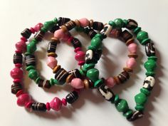 Hand rolled paper beads along with the cow bone beads makes these bracelets one of a kind. Made by a group of 100 women in Uganda that are striving to create a better life for their families and break the cycle of poverty. Fair trade & Eco-Friendly