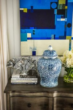 Coastal touches mixed with a white and blue color palette allude to the home's Cape Cod location and give off a fun, fresh vibe in this common space.